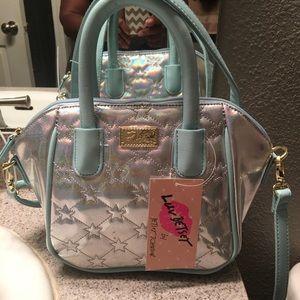 Betsey Johnson small handbag.